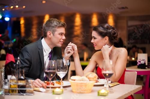 Fotobehang Restaurant couple flirting at restaurant