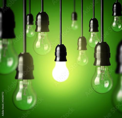 light bulbs on a green background.Idea concept.