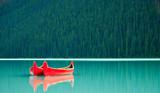 Canoes floating peacufully on Lake Louise near Banff. - 51212139