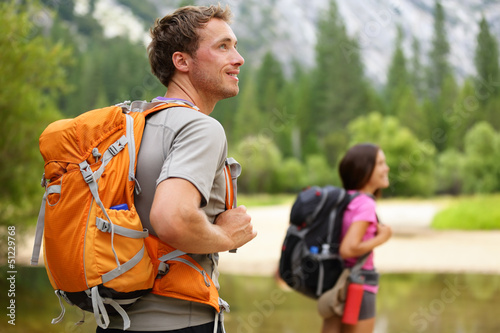 Hikers - people hiking, man looking in Yosemite Poster