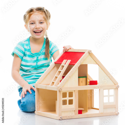 Photo  girl with a toy house