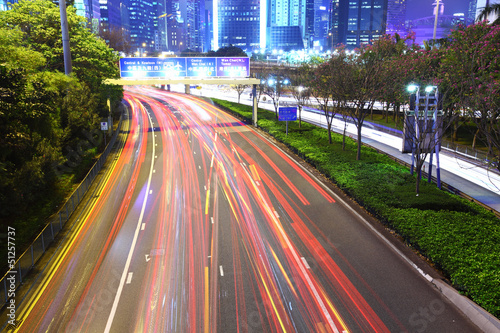 traffic in city at night Poster