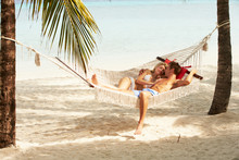 Romantic Couple Relaxing In Be...