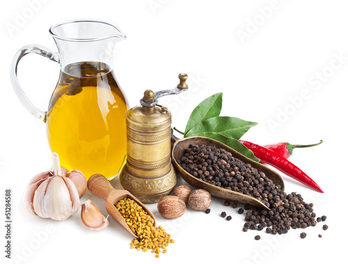 Fotografía  Retro still life with oil and spices isolated on white