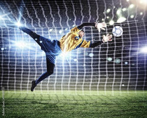 Fotobehang Voetbal Goalkeeper catches the ball