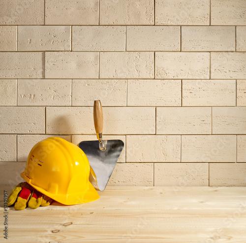 Fotografia, Obraz  brick background, trowel and helmet