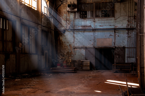 Photo Stands Old abandoned buildings inside of an abandoned factory