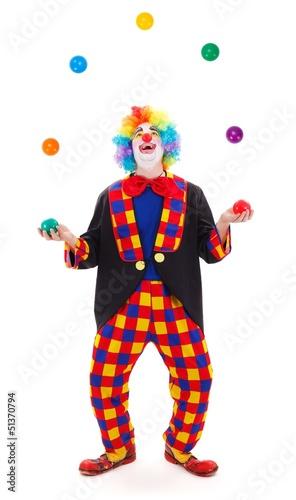 Fotografía Juggler clown throwing colorful balls
