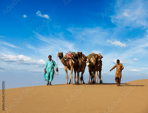 Fotografija  Two cameleers (camel drivers) with camels in dunes of Thar deser