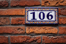 Decorated House Number On Brick Wall In Europe. Bruges (Brugge),