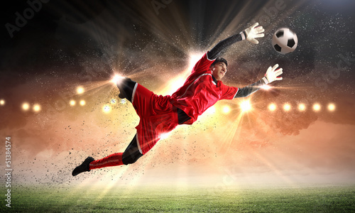 Tuinposter voetbal Goalkeeper catches the ball