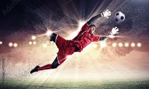 Cadres-photo bureau Le football Goalkeeper catches the ball
