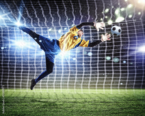 Spoed Foto op Canvas Voetbal Goalkeeper catches the ball