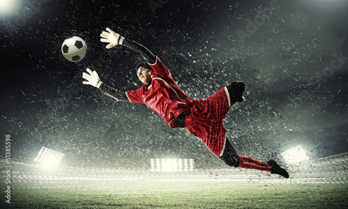 Foto Goalkeeper catches the ball