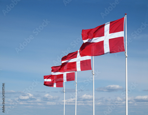 four flapping danish flags Fototapete