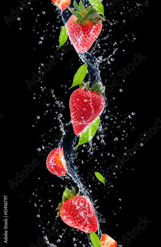 Foto op Canvas Opspattend water Strawberries in water splash, isolated on black background