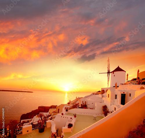 Fototapeta Windmill in Santorini against sunset, Greece obraz