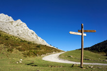 Signpost In The Mountain With Blue Sky