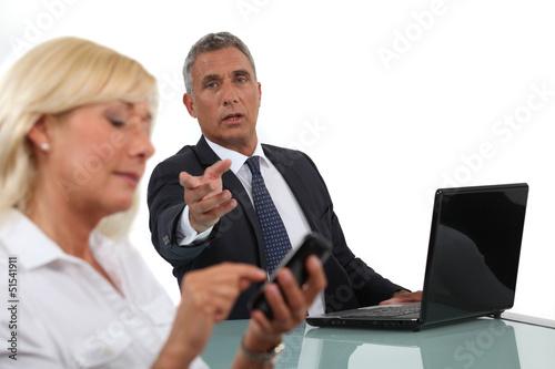 Fotografija  Businessman criticising his colleague