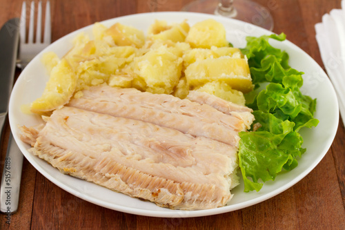 Fototapeta flounder with vegetables on the plate