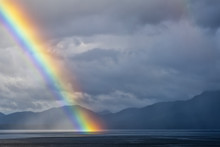 A Rainbow Going Down On The Alaskan Sea