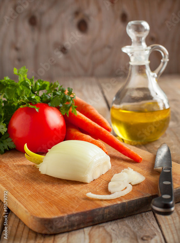Poster Pays d Asie Onion, carrots and fresh parsley on a chopping board. Ingredient