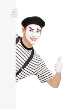 Mime Dancer Giving A Thumb Up Behind A White Panel