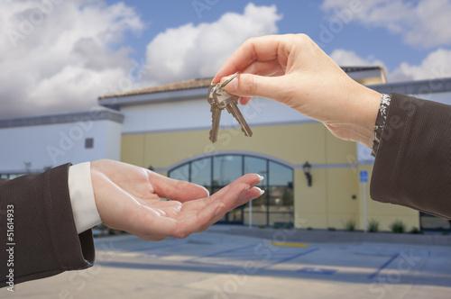 Fotografie, Obraz  Agent Handing Over the Keys in Front of Business Office