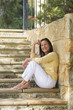 Relaxed smiling mature woman outdoor