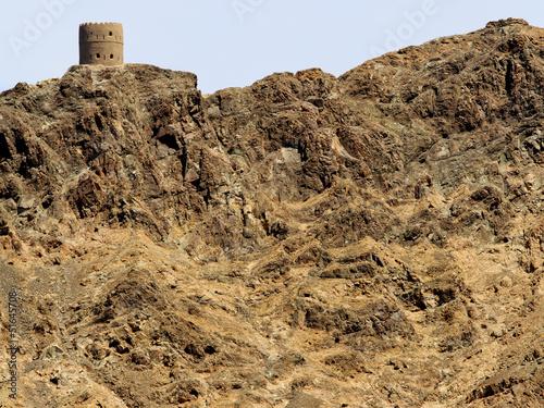 Fotobehang Midden Oosten Watchtower with interesting rock