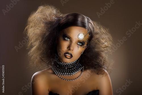 Fotografie, Obraz  Gilded Woman's Faceart. Performance. Gold Skin - Haute Couture