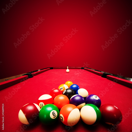 Fotografie, Obraz  Billards pool game. Color balls in triangle, aiming at cue ball