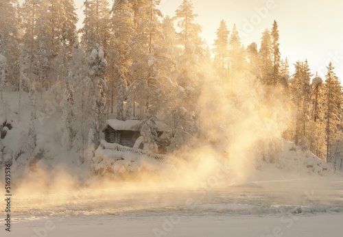 Aluminium Prints Forest in fog Small log cabin behind vaporing river