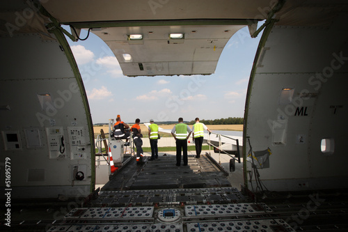 Fotografia, Obraz  Cargo compartment door of an airplane a the airport
