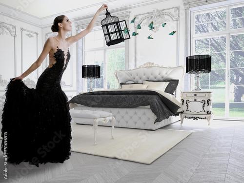 frau im schwarzem couture kleid in einem classic raum. Black Bedroom Furniture Sets. Home Design Ideas