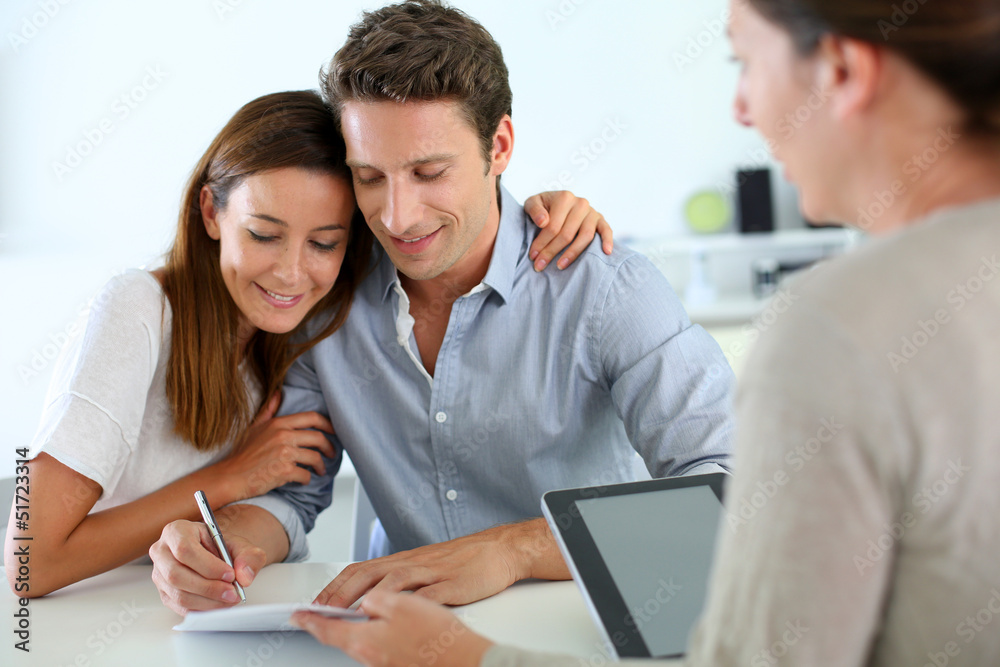 Fototapeta Couple signing real-estate contract
