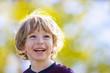 canvas print picture - Lachendes Kind in der Sonne