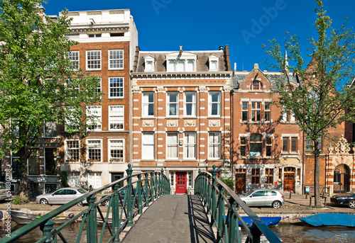 Photo  Amsterdam canal bridge and typical houses