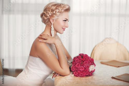 Beautiful bride in wedding dress with bouquet bridal flowers Fototapeta
