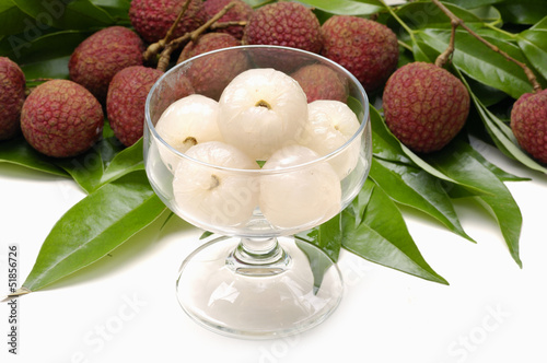 Bowl of peeled lychee with leaf