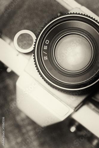 Deurstickers Retro Vintage, old film camera top view. 50mm lens. Sepia