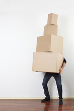 Man Lifting Cardboard Boxes In...