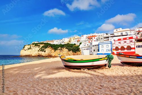 Portuguese beach villa in Carvoeiro classic fishing boats. Summe Canvas Print