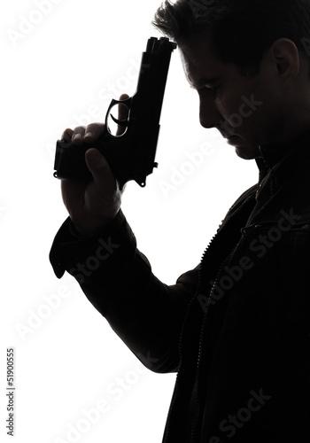 man killer policeman holding gun portrait silhouette Canvas Print