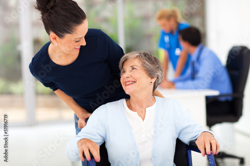 daughter accompanying senior mother to visit doctor Canvas Print