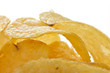 Potato crisps or chips close up on white background