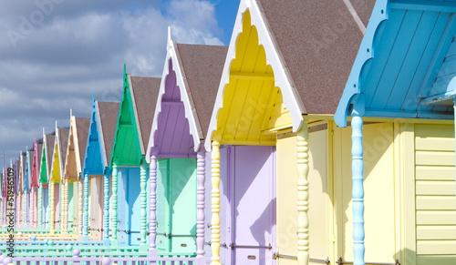 Photo Stands Traditional British beach huts on a bright sunny day