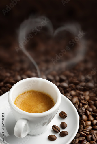 Foto op Canvas Cafe coffee cup with heart- shaped steam