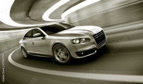 Car driving fast in tunnel