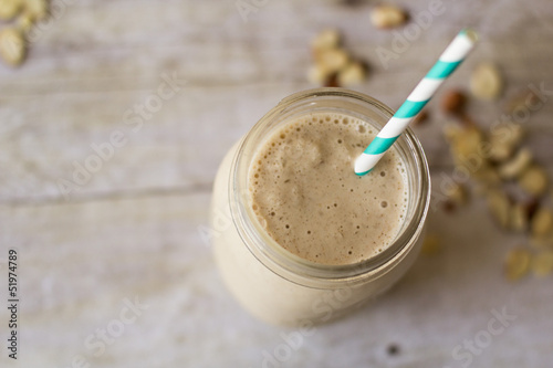 Cuadros en Lienzo  Smoothie in mason jar with aqua blue straw